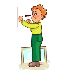 Ill little man hammers a nail to hang a picture vector