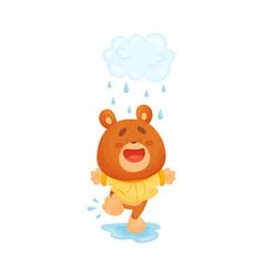 Teddy bear runs on a puddle in rain vector