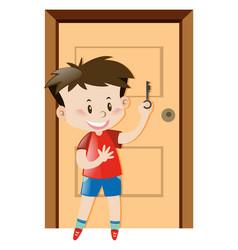 Boy holding house key vector