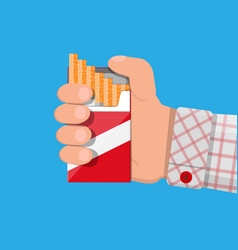 Hand with cigarette package vector