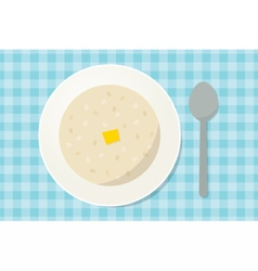 Oatmeal porridge with a piece of butter in a plate vector