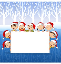 Little Kids with a blank sign and Christmas hats vector image vector image