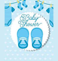 Blue little clothes hanging and shoes baby shower vector