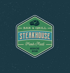 Vintage steak house logo retro styled grill vector