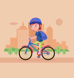 Boy rides a bike in park vector