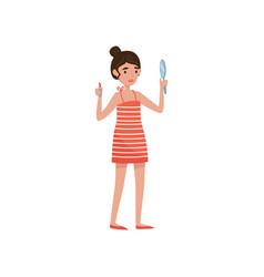 brunette girl applying lipstic beauty treatment vector image