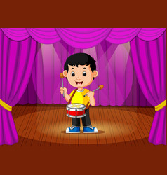 Cute boy playing drum on stage vector