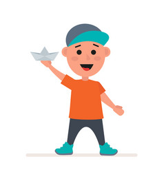 little boy in a cap with a paper boat in his hands vector image vector image