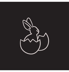 Easter bunny sitting in egg shell sketch icon vector image vector image