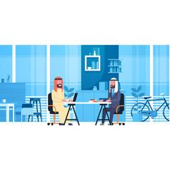 Arabic business men sitting at office desk vector