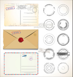 Set postal stamps and post cards on white vector