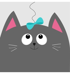 Gray cat head looking at blue bow hanging on vector