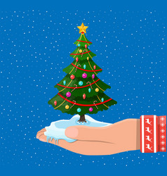 christmas tree decorated in hand vector image