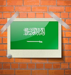 Flags Saudi Arabia scotch taped to a red brick vector