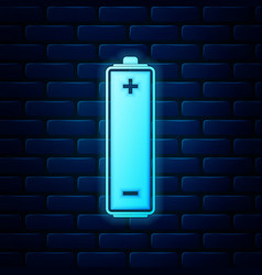 Glowing neon battery icon isolated on brick wall vector