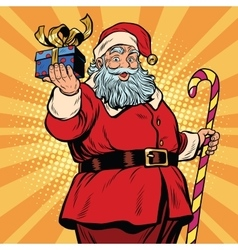 Santa Claus with a gift Christmas and new year vector image