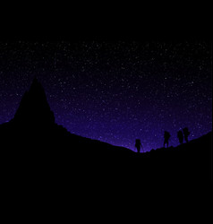 silhouette mountainers standing under mountain vector image