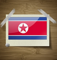 Flags Korea North at frame on wooden texture vector image