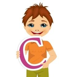little boy holding the c letter vector image