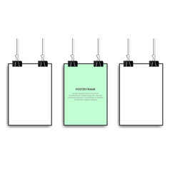 Blank posters hanging with binder clips vector