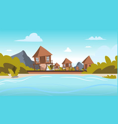 Image a village on the shore of a lagoon vector