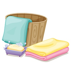 A pail with towels and a soap in a soap box vector