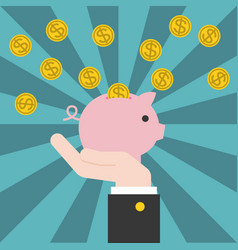 hand holding piggy bank with coins vector image
