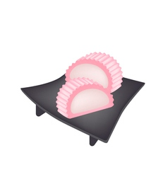 Japanese Sweet of Suama on Black Geta Plate vector