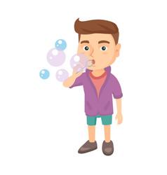 little caucasian boy blowing soap bubbles vector image