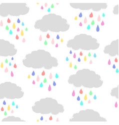Clouds and colorful raindrops vector