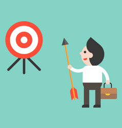 businessman holding arrow and look at target vector image