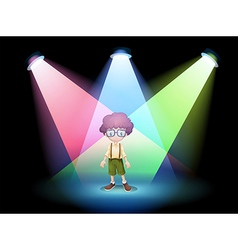 A boy wearing an eyeglass standing on the stage vector image
