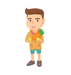 Caucasian boy holding fresh carrot vector