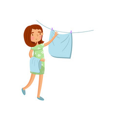 young woman in casual clothing hanging wet clothes vector image