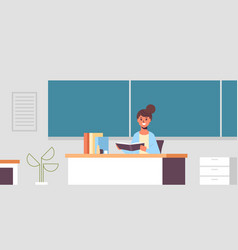 smiling teacher sitting at desk woman checking vector image