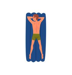 Young man sunbathing on beach towel man lying on vector
