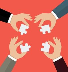Businessmen insert jigsaw pieces together vector