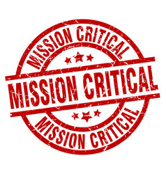 Mission critical round red grunge stamp vector