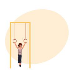 teenage caucasian boy hanging on gymnastic rings vector image vector image