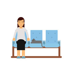 Young woman sitting in waiting hall with her cat vector