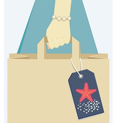 Paper bag tagged with a starfish symbol of summer vector image