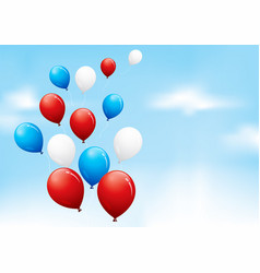 Red white and blue balloons floating in a cloudy vector