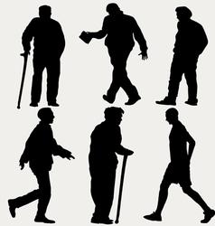 Silhouettes men walking vector