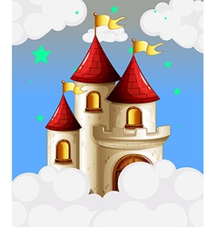 A castle in the sky with yellow banners vector image vector image