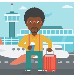 Man with suitcase and ticket at the airport vector image