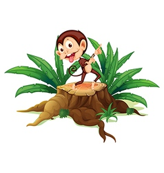 A monkey dancing above the trunk vector image