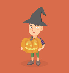 young boy holding a carved pumpkin for halloween vector image