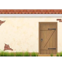 old wall grass and wooden door vector image vector image