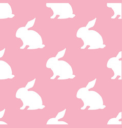 seamless pattern with silhouette of bunny on pink vector image