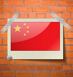 Flags China scotch taped to a red brick wall vector image